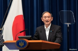 Japanese Prime Minister Suga holds a news conference in Tokyo