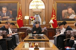 KCNA image of North Korean leader Kim Jong Un at a meeting with senior officials from the Workers' Party of Korea (WPK) Central Committee and Provincial Party Committees in Pyongyang