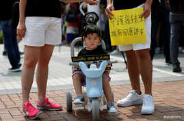 "A family participates in a protest rally titled ""Guard Our Children's Future"" at Edinburgh Place in Hong Kong, Aug. 10, 2019."