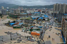 Dajing town is seen damaged and partially submerged in floodwaters in the aftermath of Typhoon Lekima in Leqing, Zhejiang province, China, Aug. 10, 2019.