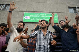 Demonstrators shout slogans outside a hospital emergency unit during a protest after the Indian government scrapped special status for Kashmir, in Srinagar August 9, 2019. REUTERS/Stringer NO ARCHIVES. NO RESALES.