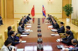 Wang Yi, China's State Councilor and Foreign Minister, and his delegates meet with North Korean Foreign Minister Ri Yong Ho in Pyongyang, North Korea in this September 2, 2019 photo released by North Korea's Korean Central News Agency (KCNA).   KCNA via REUTERS    ATTENTION EDITORS - THIS IMAGE WAS PROVIDED BY A THIRD PARTY. REUTERS IS UNABLE TO INDEPENDENTLY VERIFY THIS IMAGE. NO THIRD PARTY SALES. SOUTH KOREA OUT. NO COMMERCIAL OR EDITORIAL SALES IN SOUTH KOREA.
