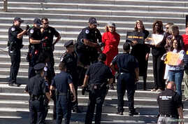 Jane Fonda is seen being arrested during a climate change protest in Washington, U.S., October 11, 2019. in this picture…