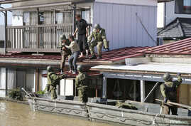 Local residents are rescued by Japapnese Defence-Force soldiers from a flooded area caused by Typhoon Hagibis in Kakuda, Miyagi…