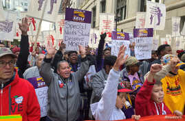 Hundreds of teachers and supporters march, days before the teacher's union was set to go on strike if a contract settlement was…