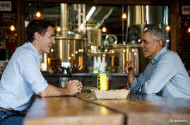 FILE PHOTO: Canada's Prime Minister Justin Trudeau and former U.S. President Barack Obama meet at Big Rig brewery in Kanata,…