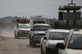 Turkey-backed Syrian rebel fighters return from the Syrian border town of Tal Abyad, as they are pictured on the Turkish-Syrian…