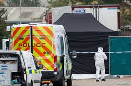 Police is seen at the scene where bodies were discovered in a lorry container, in Grays, Britain