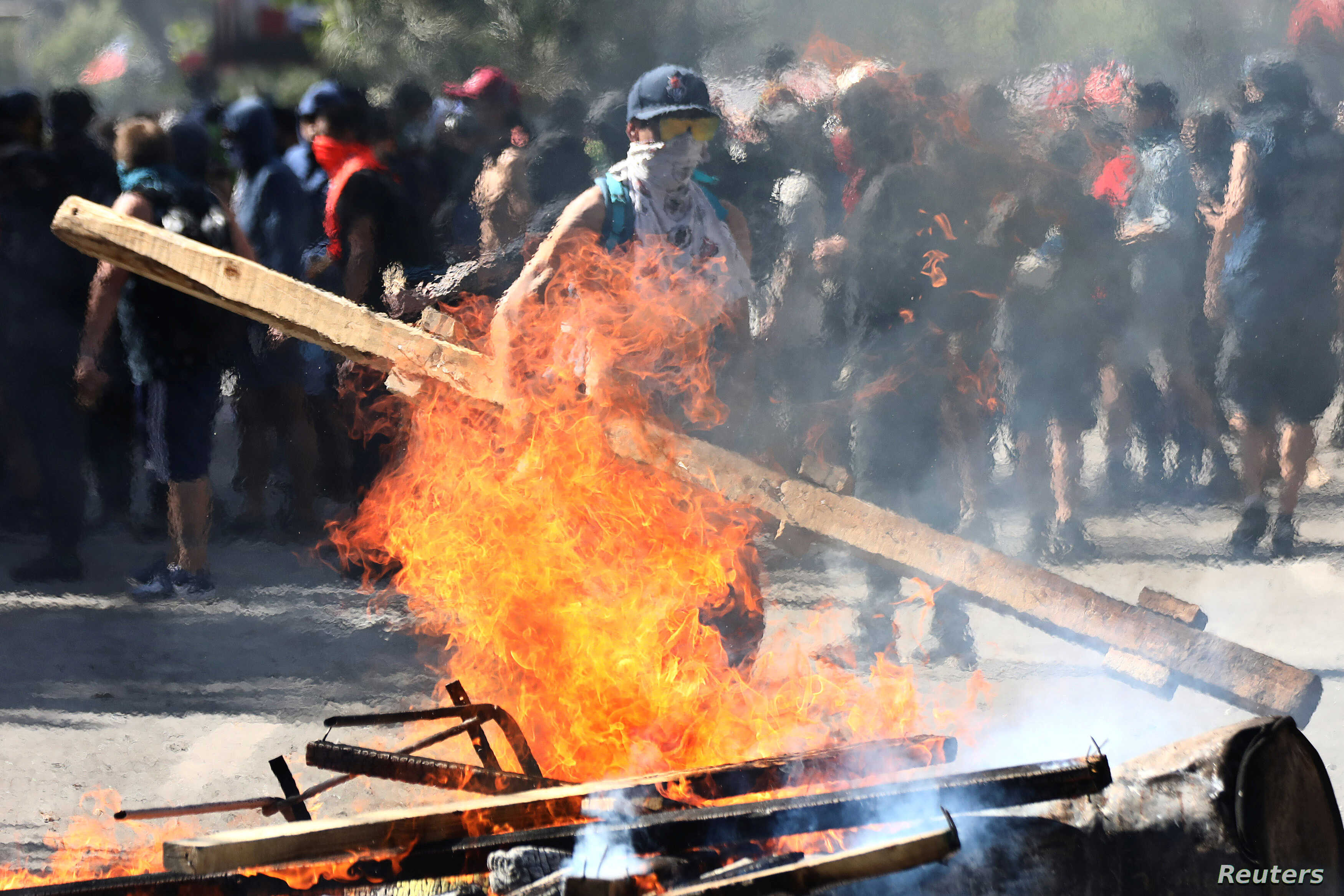 A demonstrator sets a barricade on fire during a protest against Chile's state economic model in Santiago October 24, 2019…