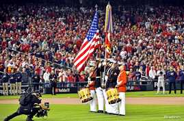 Oct 26, 2019; Washington, DC, USA; The American flag is presented for the national anthem before game four of the 2019 World…