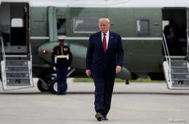 U.S. President Donald Trump walks from the Marine One presidential helicopter prior to departing O'Hare International Airport…