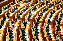 Deputies of Vietnam's National Assembly attend the opening ceremony of the Autumn session in Hanoi, Vietnam October 22, 2018…