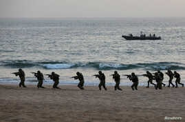 Pakistan Navy's special service group conduct a maritime counter-terrorism demo during Pakistan Navy's Multinational Exercise…