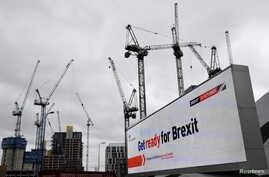 FILE PHOTO: An electronic billboard displaying a British government Brexit information awareness campaign advertisement is seen…