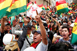 People shout slogans during a protest against Bolivia's President Evo Morales in La Paz, Bolivia, November 9, 2019. REUTERS…