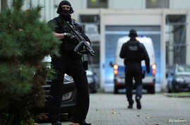 German special police arrive with a suspect (not pictured) of a planned bomb attack on behalf of the Islamic State militant…