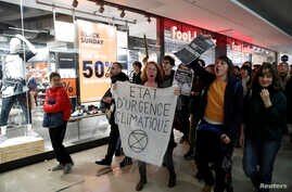 Youth for Climate activists demonstrate inside the Westfield Les 4 Temps shopping center during a day of protest to denounce…