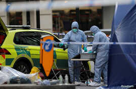 Forensic officers work at the scene of a stabbing on London Bridge, in which two people were killed, in London, Britain,…