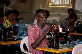 Eritrean refugees sew cloth during a training in Hitsats refugee camp during the visit of the Crown Prince of Norway, Haakon…