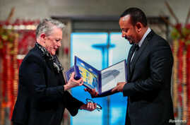 Ethiopian Prime Minister Abiy Ahmed Ali receives medal and diploma from Chair of the Nobel Comitteee Berit Reiss-Andersen…
