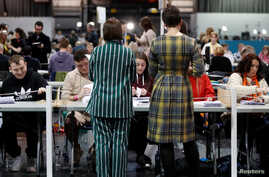 Ballots are tallied at a counting centre for Britain's general election in Glasgow, Britain, December 12, 2019.  REUTERS…
