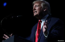 U.S. President Donald Trump delivers remarks at the Turning Point USA Student Action Summit at the Palm Beach County Convention…