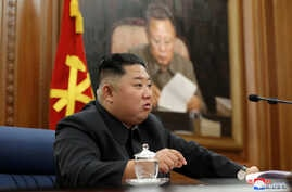 North Korean leader Kim Jong Un speaks during the Third Enlarged Meeting of the Seventh Central Military Commission (CMC) of…