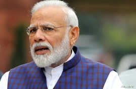 FILE PHOTO: India's Prime Minister Narendra Modi speaks to the media inside the parliament premises on the first day of the…