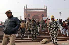 Police patrol the steps of Jama Masjid before Friday prayers in the old quarters of Delhi, India, December 27, 2019. REUTERS…