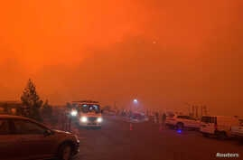 The sky glows red as bushfires continue to rage in Mallacoota, Victoria, Australia, December 31, 2019, in this photo obtained…