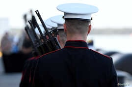 "FILE PHOTO: U.S. Marines prepare for the ""Rifle Salute"" during ceremonies marking the 75th anniversary of the attack on Pearl…"