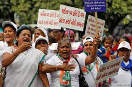 Supporters of India's main opposition Congress party shout slogans during a protest against the alleged rape and murder of a 27…