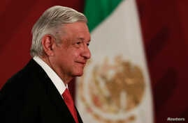 FILE PHOTO: Mexico's President Andres Manuel Lopez Obrador looks on during a news conference at the National Palace in Mexico…