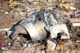 FILE PHOTO: Debris of a plane belonging to Ukraine International Airlines, that crashed after taking off from Iran's Imam…