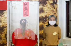 A Taiwanese voter stands at a polling booth during the general elections in Kaohsiung, Taiwan, January 11, 2020. REUTERS/Ann…