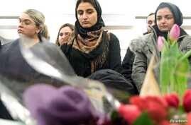 Mourners attend a vigil in memory of Iranian student Amir Moradi, who was killed in the crash of a Ukrainian passenger plane…