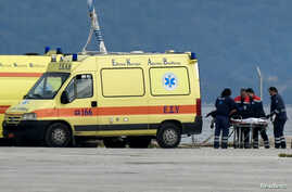 The body of a migrant is pushed by medical staff into an ambulance at the port of Preveza, Greece, January 11, 2020. Yorgos…