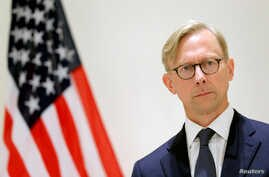FILE PHOTO: Brian Hook, U.S. Special Representative for Iran, attends a news conference in London, Britain June 28, 2019…