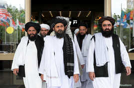 FILE PHOTO: File picture of members of a Taliban delegation leaving after peace talks with Afghan senior politicians in Moscow,…