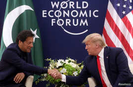 U.S. President Donald Trump shakes hands with Pakistan's Prime Minister Imran Khan during a bilateral meeting at the 50th World…