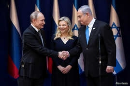 Israeli Prime Minister Benjamin Netanyahu and his wife Sara receive Russian President Vladimir Putin ahead of the World…