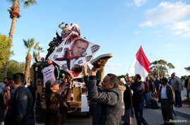Supporters of Libyan National Army (LNA) commanded by Khalifa Haftar, hold a picture of Turkish President Tayyip Erdogan as…