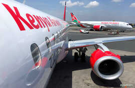 Kenya Airways planes are seen parked at the Jomo Kenyatta International Airport near Nairobi, Kenya November 6, 2019. REUTERS…