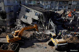 Rescue workers search the site of a collapsed building, after an earthquake in Elazig, Turkey, January 26, 2020. REUTERS/Umit…