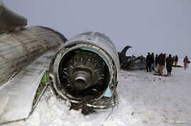 The wreckage of an airplane is seen after a crash in Deh Yak district of Ghazni province, Afghanistan January 27, 2020.   NO…