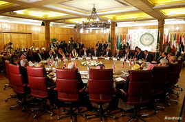 A general view shows a meeting of the Arab League's foreign ministers after U.S. President Donald Trump announced his Middle…