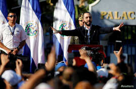 FILE PHOTO: Salvadoran President Nayib Bukele gestures as he addresses his supporters protesting outside the national congress…