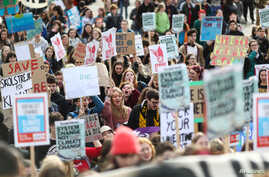 Students hold banners as they attend a climate school strike in London, Britain, February 14, 2020. REUTERS/Simon Dawson