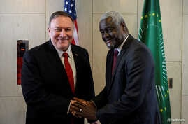 U.S. Secretary of State Mike Pompeo shakes hands with African Union Commission Chairperson Moussa Faki Mahamat at the African…