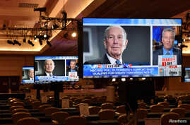 An image of Democratic presidential candidate Michael Bloomberg appears on a video monitor inside the media center for…
